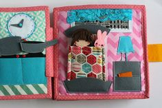 Travel fabric Dollhouse book with felt paper doll.  Very detailed dollhouse with lots of removable items (like food, kitchenware, clothes and many more), opening doors, lifting curtains, dressing... every girls dream :) The dollhouse will be interesting to children from age they understand pretend play (about two years old). Removable pieces are very small and not suitable for children under 3. You may order adjusted dollhouse for younger children with bigger removable pieces. PAGES Please…