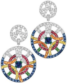 Café Society #Earrings from #CafeSociety - #Chanel - #FineJewelry collection in 18K white gold set with 2 #CushionCut - #Sapphires (2.4 cts), 42 #SquareCut sapphires (6.1 cts), 32 S.C. #YellowSapphires (2.3 cts), 110 #BrilliantCut - #Diamonds (5.4 cts), 2 #BaguetteCut diamonds, 38 S.C. #RedSpinels (3.2 cts), 38 S.C. #OrangeGarnets (3.6 cts) and 26 S.C. #Tsavorites (3.0 cts) - July 2014