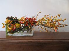 Long and low designs are great for fall tables, consoles and coffee tables. Berries and persimmons will last for weeks....
