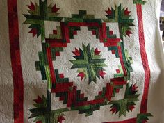 Beautiful quilting on this Christmas Cactus Star wall hanging. PIeced by Betty Cotter. Quilted by Jessica's Quilting Studio