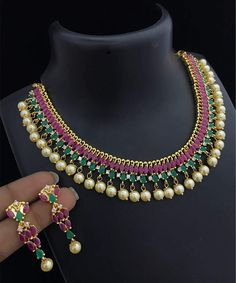 High quality grand wedding party wear choker Necklace with Emerald marquise Zircon stones and south sea pearls. This exclusive American Diamond Necklace is Made of Brass base Metal studded with the Simulated American Diamond Stones with gold plating. Diamond Cross Necklaces, Diamond Solitaire Necklace, Diamond Pendant Necklace, Diamond Jewelry, Pearl Pendant, Necklace Set, Gold Necklace, Kendra Scott, Bridal Jewelry