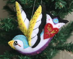 A personal favourite from my Etsy shop https://www.etsy.com/au/listing/468304737/handmade-felt-swallow-ornament