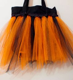 We made this DIY Trick or Treat Bag with a store bought canvas bag and a homemade tulle tutu skirt. It will look cute with any kid's Halloween costume and it is so easy to make. Follow us for more great Halloween craft ideas.