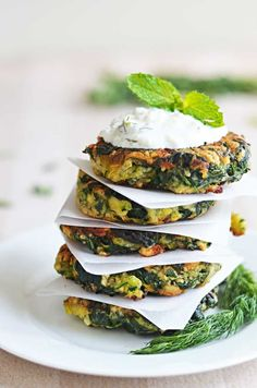Zucchini, Feta, and Spinach Fritters with Garlic Tzatziki! Great for appetizers or a light snack, and a fantastic way to sneak in some veggies!   hostthetoast.com