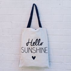 These fun canvas shopper bags are perfect for folding down and popping in your handbag so you're never caught short at the shops! This shopper collection is available in 4 different fun handwritten style slogans. Mid length twin handles ideal for carrying over your shoulder. Cream fabric with black print on one side and plain black fabric on the inner side.