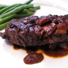 Beef flat iron steaks get a spicy rub and a quick sear, and are served with a hearty red-wine and mushroom sauce.