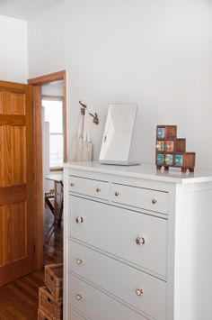 Tiffany's Naturally Sunlit Bedroom   ApartmentTherapy  --  Love the fancy dresser knobs and the pop of color from the tiny little decorative drawer stair-step...thingy. :)