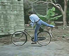 """♡♥A few of the Beatles getting off their moving bicycles in the 'Help"""" movie in 1965 GIF pic - click on GIF pic to see a full screen GIf pic in a better looking black background♥♡ The Beatles Help, Gif Pictures, Bicycles, Black Backgrounds, The Help, How To Look Better, Movies, Films, Cinema"""
