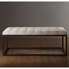 Add a unique flair to your decor with this stylish coffee table ottoman by Renate. Made with a solid metal frame to ensure its durability, this table has a tufted, foam-filled top that enhances its beauty and makes it comfortable to sit on.