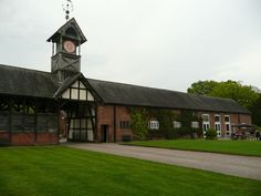 Arley Hall, clock tower with The Ride on the left & the Tudor barn (1602) on the right