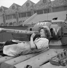 Female worker at the B. T. H. factory in Neasden Lane Willesden in London England United Kingdom writing messages on a Covenanter tank of British Guards Armoured Division 22 Sep 1942