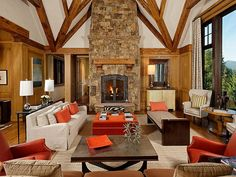 Stone Fireplace Orange Accents Rustic Decor | Aspen, Colorado | Aspen Snowmass Sotheby's International Realty