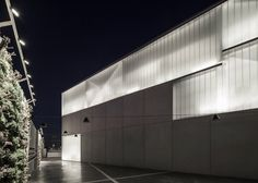 """Events hall by Pitsou Kedem, Rishon LeZion, Izrael  Building clad in translucent glass-plank facades designed to """"glow like a firefly"""" at night."""