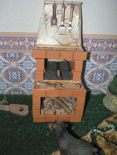 View of miniature brick cookstove + scenes of rustic laundry room (image only) | Source: Las casitas de Narán