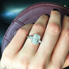 """My new """"little"""" friend is this Amal Clooney style Emerald Cut diamond engagement ring. Well granted Amal's ring is a 6-7ct but let's not complaint here because this ring is a stunning four and half carat star! Platinum. F VVS2 GIA."""