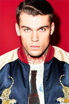 Front and center, Stephen James wears a Jack & Jones bomber jacket with Replay jeans and a Nudie Jeans t-shirt.