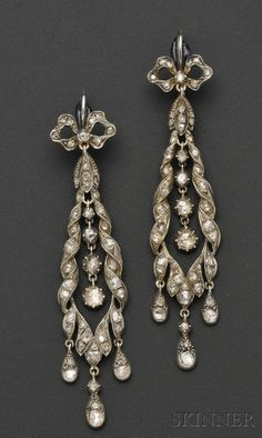 Antique Diamond Earpendants, each with bow and ribbon motifs set throughout with foil-back rose-cut diamonds, and suspending drops, silver mount, reverse with engraved foliate accents. Paris. 18th-early 19th century (?)