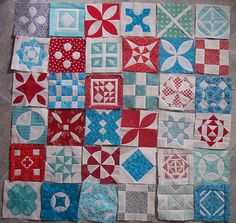 Red and Aqua Dear Jane quilt.