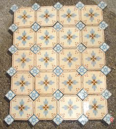 Pretty octagonal antique tiles with floral inserts - The Antique Floor Company
