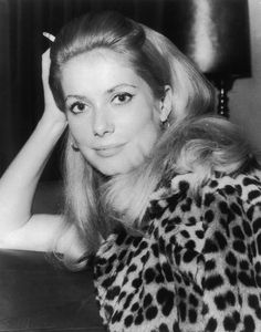 """Debuting at age 11 in the boarding school drama Les Collégiennes, Deneuve sang her way through the color-drenched Les Parapluies de Cherbourg before putting the belle in Belle de Jour (in costumes by YSL).  Deneuve's aloof froideur was captured in her 1970s ads for Chanel No. 5, and in her tenure as national icon Marianne (1985-89). While she has described """"beauty [as] a burden,"""" it's one the grande dame of French cinema has borne lightly."""