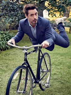 ROBERT DOWNEY JR. does some planking. Stark Industries' two-wheeled subsidiary, Linus Bikes.