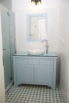 Bathroom- love the painted vanity. Maybe for our guest bath.