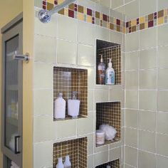 built-in cubbies. Wow, what a great way to declutter your bath tub area. I want this when we build our house.