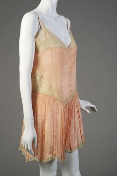 Combination (Teddy). American 1920s. Peach silk trimmed with lace. Gift of Mina Neiger Kulber, KSUM 1986.79.1