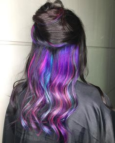 Hidden rainbow hair is the beauty trend you should try if you're wanting to all color to your hairstyle.