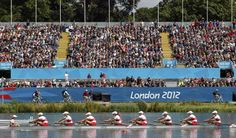 The Canada team rows in the women's eight heat at Eton Dorney during the London 2012 Olympic Games