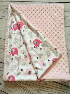 A personal favorite from my Etsy shop https://www.etsy.com/listing/500592649/personalized-baby-blanketpink-minkypink