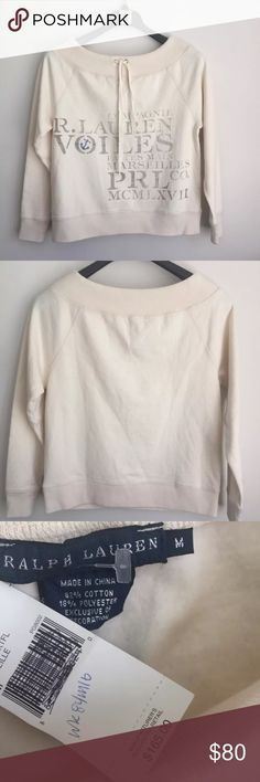 """Ralph Lauren Boatneck Ivory Knit Sweatshirt NEW Women's Ralph Lauren Blue Label Natural Ivory Fleece Sweatshirt Boat Neck Tie Long Sleeve Ivory cream color with front graphics Blue embroidered anchor 82% Cotton 18% Polyester Brand new with tags MSRP $165  Women's Size M. Measures 20"""" across chest arm pit to arm pit laying flat. Length is 203 long from top of shoulder to bottom. Ralph Lauren Sweaters"""