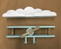 Baby Blue and Brown Handcrafted Wooden Airplane and White Cloud Shelf Combo Adorable to hang in a nursery, childs room or playroom. Handcrafted by my family of solid pine wood. A lot of time and energy are spent making round smooth edges and constructing each and every shelf. We strive to do our best in everything and strive to make a product that we are proud to display in our own home. We can customize the shelf with any color/s you would prefer just send us a message. Approx. Airpla...