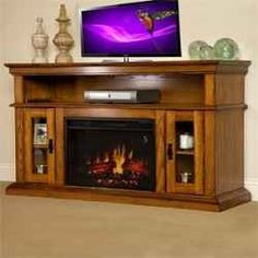 The Brookfield Infrared Electric Fireplace Entertainment Center in Premium Oak - is the perfect unit for those looking for a traditional design. Complementary to most and decor the Broo. Cheap Electric Fireplace, Electric Fireplaces Direct, Electric Fireplace Tv Stand, Electric Fireplace Entertainment Center, Entertainment Centers, Entertainment Wall, Infrared Fireplace, Home Goods, Entertaining