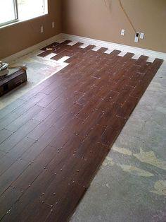 Tile that looks like hard wood floor! Amazing