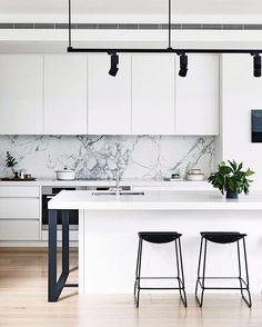 This Backsplash with dark cabinets and gold faucet or gold sink and black fixtures