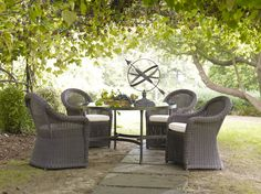 Al fresco under the arbor. (Table and chairs from the new Portico collection.)  always loved this look ... Ethan Allen