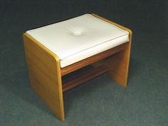 A lovely vintage retro lift top dressing table stool Padded white leatherette seat with central button detail Seat lid lifts to reveal useful storage area Teak style veneer legs with solid teak supports Dressing Table With Stool, Dressing Tables, Antiques Online, Storage Area, Teak, Retro Vintage, Ottoman, Button, Interior Design