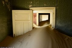 Nature takes over: Sand has infiltrated the windowless and sometimes roofless homes...