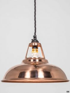 Copper Coolicon pendant light. Every Factorylux light shade is made in the UK by skilled metalworkers. The copper Coolicons are created by spin forming a flat disc of pure copper and they are still shaped by hand. The fine concentric spinning lines remain visible on the shade.