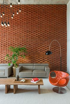 Image 21 of 37 from gallery of Brick Curtain House / Design Work Group. Photograph by phxindia Brick Cladding, Brick Facade, Facade House, Brick Interior, Home Interior Design, Brick Wall Decor, Bungalow Haus Design, Brick Projects, Feature Wall Design