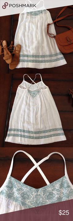 BCBG Maxazria Sundress, Size S BCBG Maxazria Sundress, Size S. White with light blue embroidery. Criss cross straps in the back. Never been worn. Excellent condition. BCBGMaxAzria Dresses