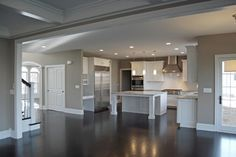 Sherwin Williams Mega Greige - Custom Floor Plan APS Kitchen with offset dinette area