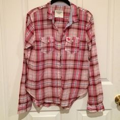 pink flannel thin pink flannel from Abercrombie and Fitch! sleeves and collar have striped design on the inside. worn once or twice size:small Abercrombie & Fitch Tops Button Down Shirts