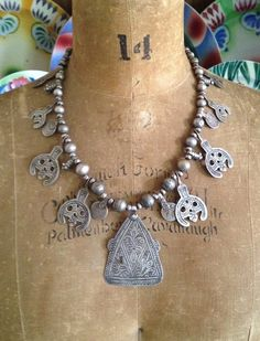 images and items for sale featuring antique Moroccan Berber silver amulets, talismans, and old silver beads