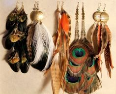 feathers... Love them as earrings-not so much in the hair...