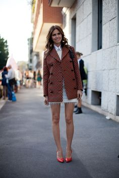 STREET STYLE SPRING 2013: MILAN FW - Dasha Zhukova is tailored in a graphic jacket and red pumps.