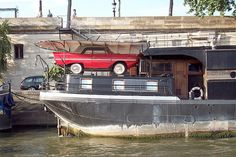 That's not just any old car parked on a boat - it's an Amphicar — a combo car and boat first made in the early 1960s.