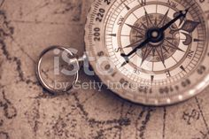 Compass and map close-up royalty-free stock photo Cartography, Compass, Pocket Watch, Close Up, Royalty Free Stock Photos, Map, Accessories, Location Map, Maps