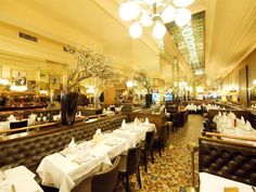 Simple white linens with flowers or candles or both.... Terminus Nord, restaurant, brasserie, Paris, France